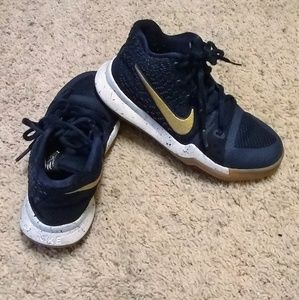 Kids blue and gold Nike shoes